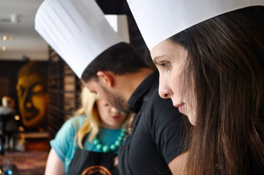 Lorna, looking very serious DESPITE wearing a chef hat